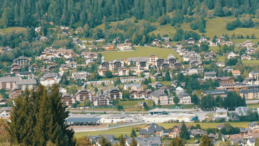 A large number of wooden houses in a ski resort, in the valley of the Austrian Alps | Shutterstock HD Video #32972287