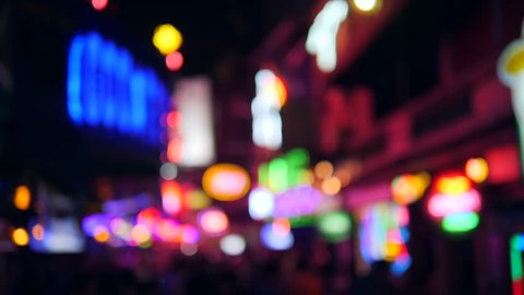 Colorful Blurry Neon Bar Signs Lightings with Amazing Bokeh Background. Sexual Tourism Streets and Night Life in Bangkok, Thailand. 4K.