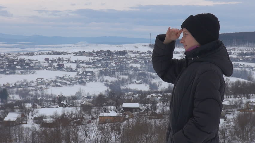 Young woman admire her village in winter time, pan | Shutterstock HD Video #3298346