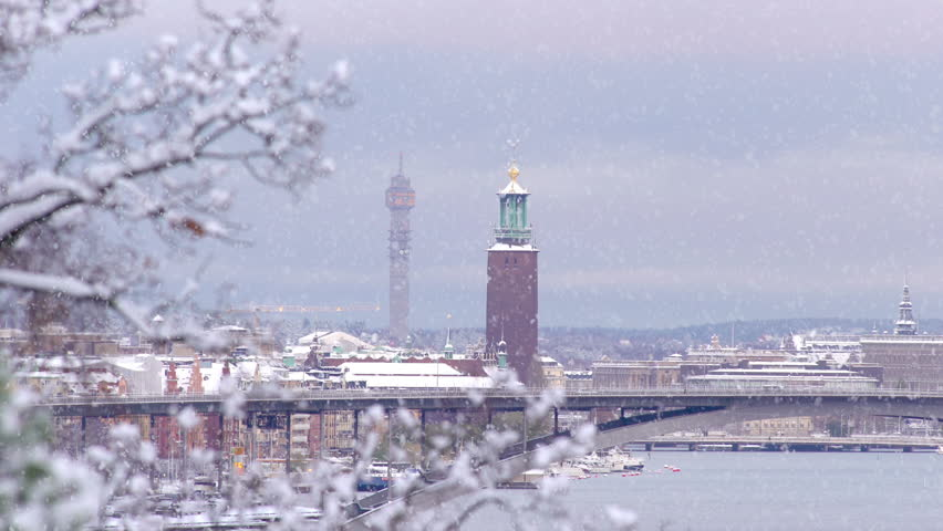 Slow motion clip of snowfall in Stockholm on a wintry day at dusk.