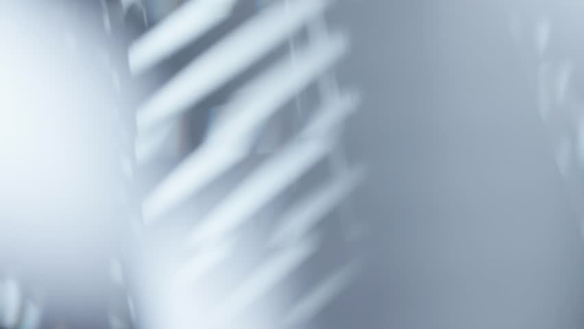 Abstract motion background with white stripes and mirror reflections.