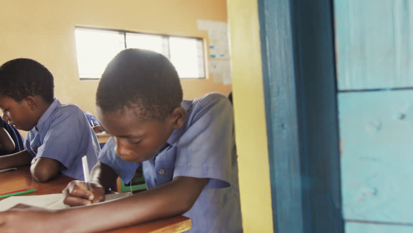 4k close view of pupils in classroom of African children writing English in school notebooks. | Shutterstock HD Video #33009775