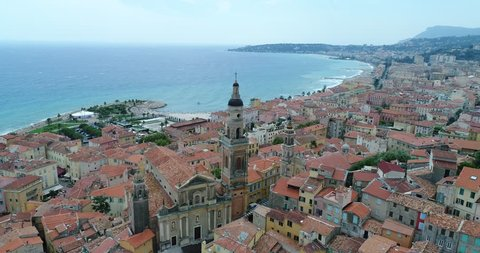 Aerial of France, Cote d'azur, Menton, old city houses and sea in French riviera, 4K