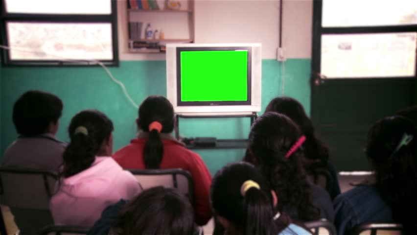 Watching television in School Class, Ready to replace green screen with any footage or picture you want.  | Shutterstock HD Video #33020071