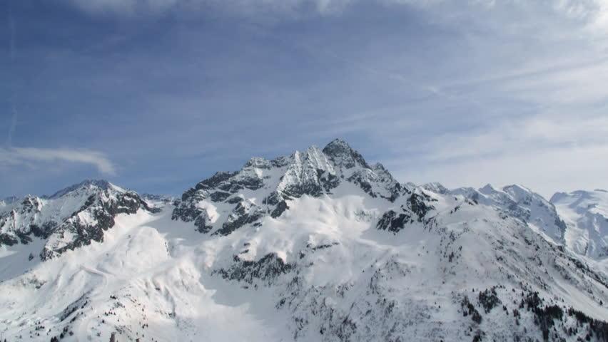Snowy mountain top with blue sky time lapse of Adamello, Tonale in italian alps   Shutterstock HD Video #33022216