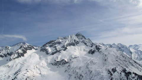 snowy mountain top with blue sky time lapse of Adamello, Tonale in italian alps
