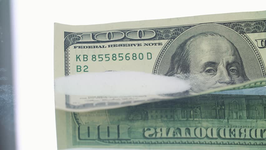 Cocaine powder on the one hudred dollar bank notes    Shutterstock HD Video #33031006