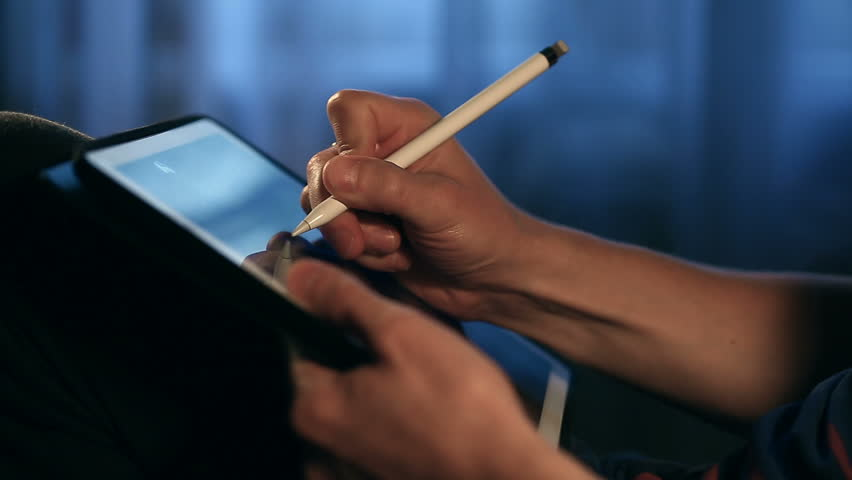 Closeup shot of designer's hand scaling and drawing a sketch on tablet using stylus at home.  | Shutterstock HD Video #33082771