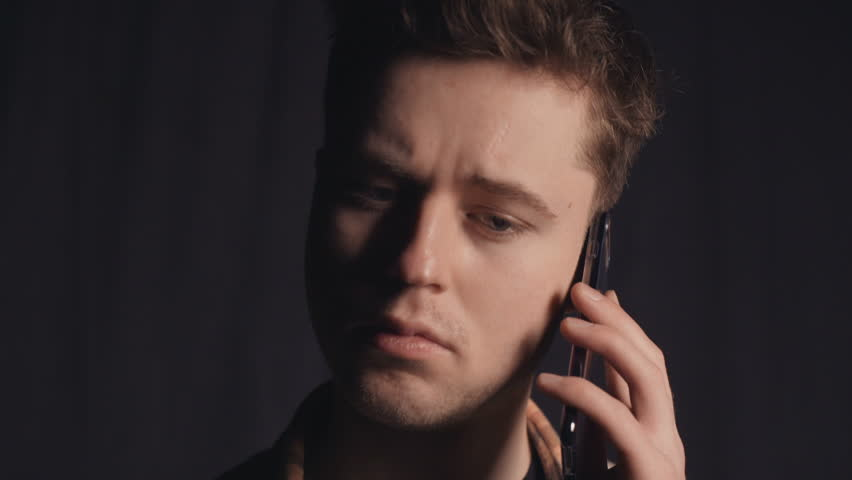 Portrait of a sad man who telephoned and found out unpleasant news | Shutterstock HD Video #33109963