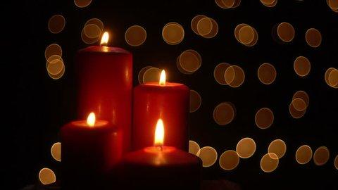 Red candels lights on bokeh background