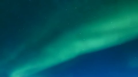 Aurora borealis lights, arctic northern light in blue sky, night arctic lights time,clean weather day.Time laps from the Aurora Borealis,Bright aurora borealis northern lights realistic movement snowy