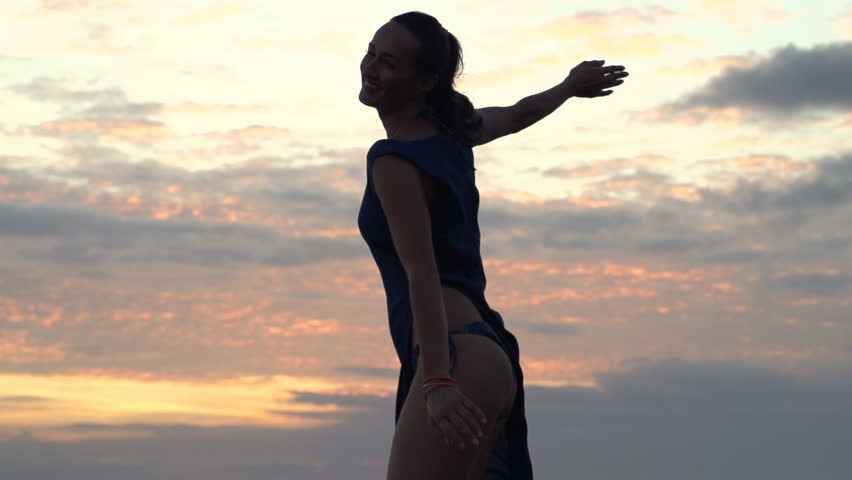 Happy, sexy woman dancing during sunset, super slow motion 240fps
