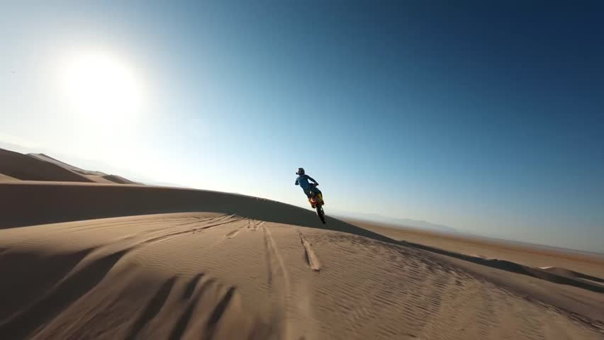 Motocross Motorcycle Rider Drives on the Off-Road Sand Terrain