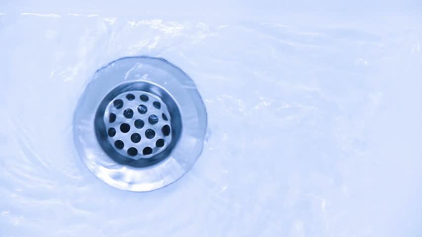 water running down the drain, weak stream of water