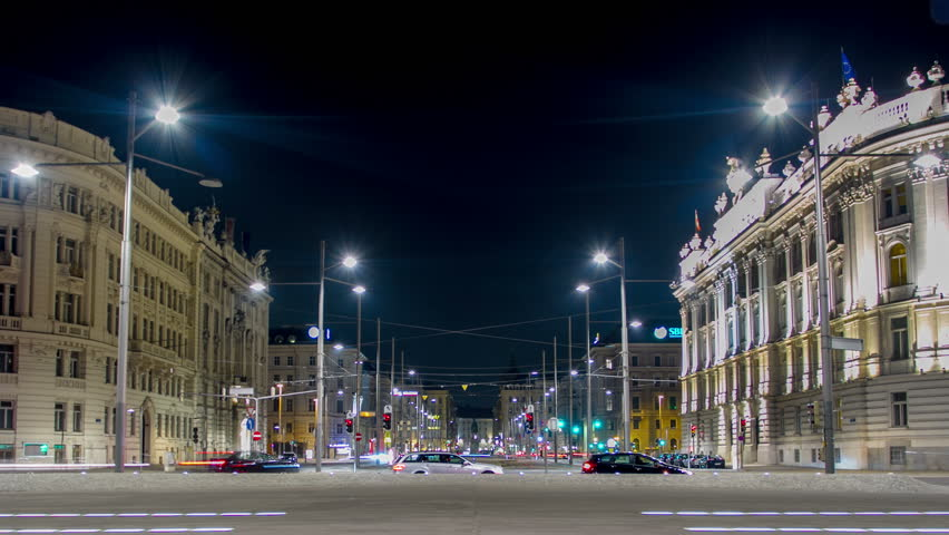 In this time nightly lapse shot the camera moves upwards and shows the viennese Schwarzenbergplatz. Cars and public transport leave colourful lines in the frame.