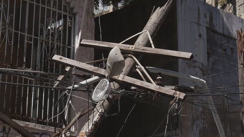 San Juan, Puerto Rico - September 2017: Hurricane Maria aftermath - broken electrical distribution pole split in two.