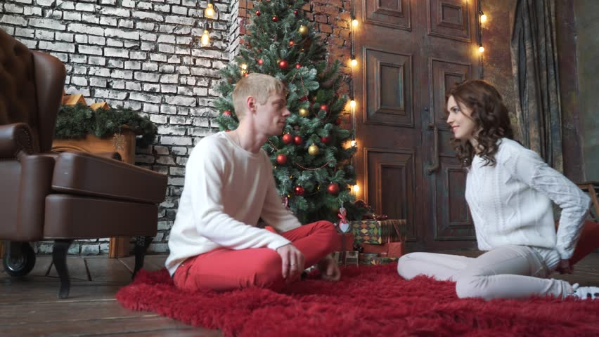 A Boyfriend For Christmas.The Girl Gives Her Boyfriend Stock Footage Video 100 Royalty Free 33242326 Shutterstock