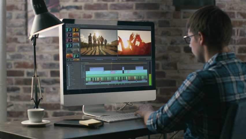 Video Editor Works with Footage and Sound on His Personal Computer. His Office is Modern and Creative Looking. Shot on RED Epic 4K UHD Camera.