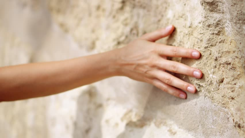 Woman's hand moving over old stone wall. Sliding along. Sensual touching. Hard stone surface. Sensory experience | Shutterstock HD Video #33267796