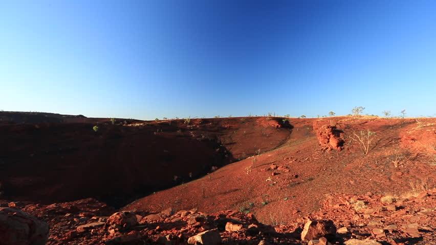 Beautiful landscape footage of Yandi iron ore red rocks mine site, outback Perth, Western of Australia