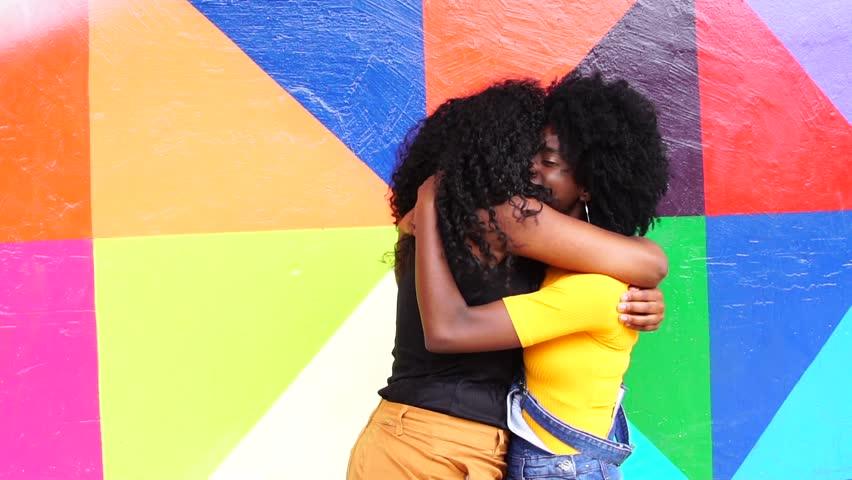 Women meeting and hugging