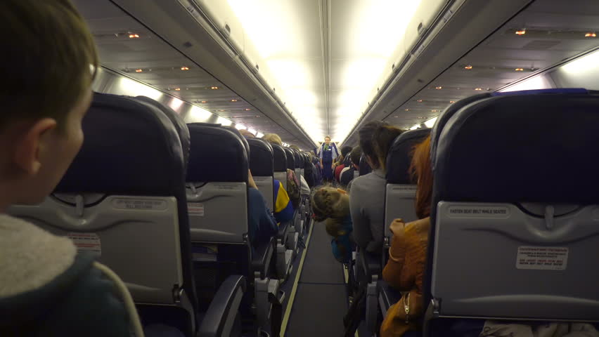 Moscow, Russian Federation – March 19, 2017: Interior of airplane with passengers on seats.