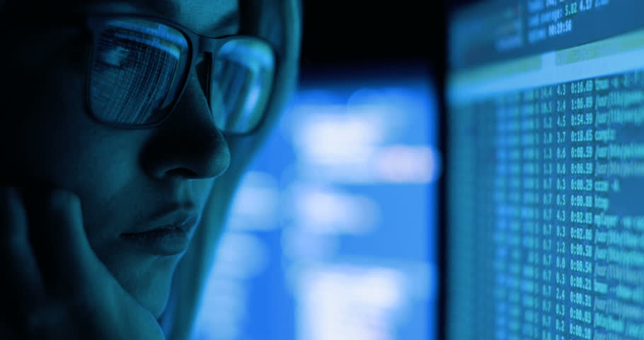 Woman working with computer, hacking and writing. Computer screen and code reflected in woman's glasses. | Shutterstock HD Video #33360367