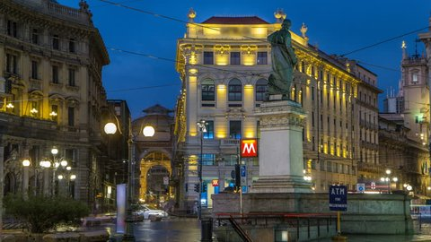 Cordusio Square and Dante street with surrounding palaces, houses and buildings day to night transition timelapse in Italian capital of fashion and luxury. Monument to writer and poet Giuseppe Parini