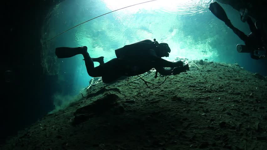 Cave divers swimming in undeground passages. Cenote underwater diving in Mexico. | Shutterstock HD Video #33421246
