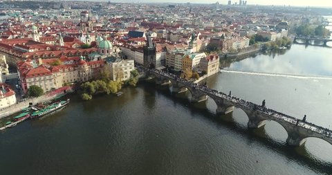 Panoramic view from above on the Prague Castle, aerial of the city, view from above on the cityscape of Prague, flight over the city, top view, Vltava River, Charles Bridge, Prague, October, 2017