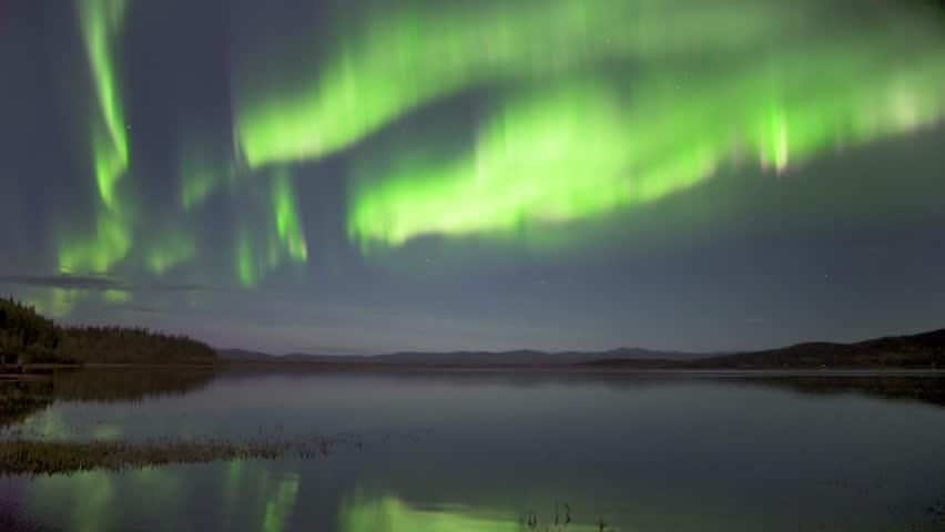 Real time (not a timelapse) strong green and pink aurora borealis (northern lights) dancing over lake in Alaska with realistic movement | Shutterstock HD Video #33431056