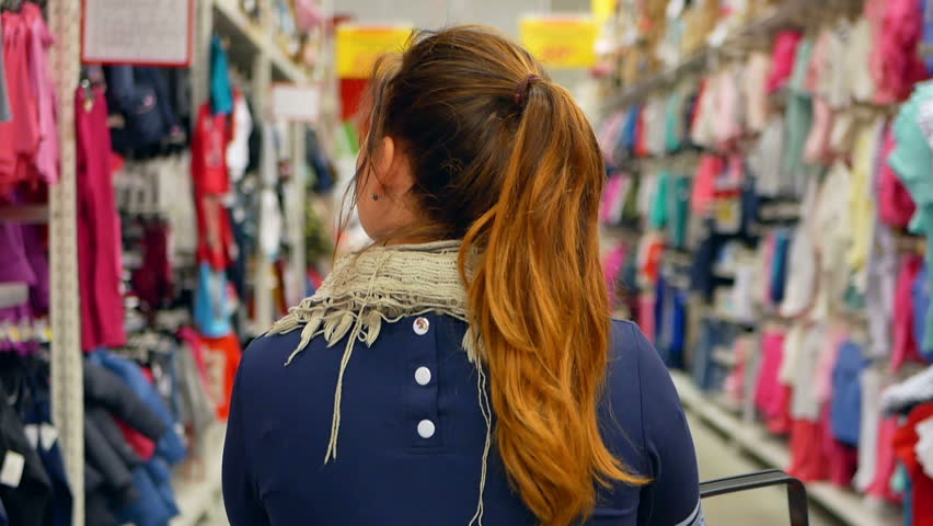 Woman shopping at the supermarket, follow shot from back | Shutterstock HD Video #33445486