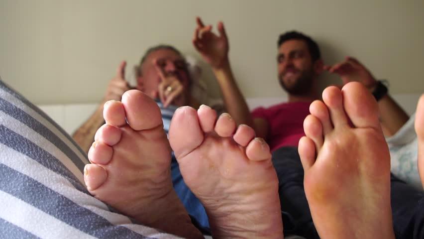 Mom gives son a footjob