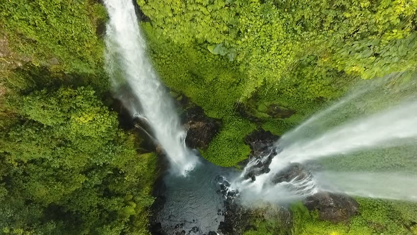 Waterfall in green rainforest. Aerial view of triple waterfall Sekumpul in the mountain jungle. Bali,Indonesia. Travel concept. Aerial footage.