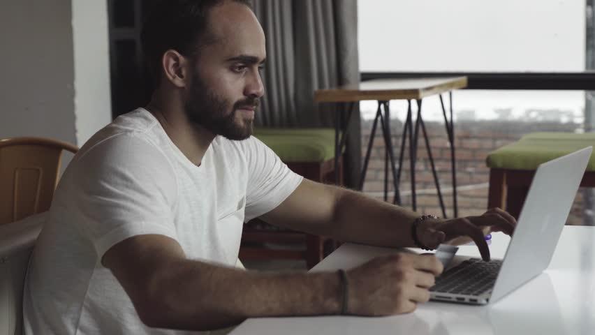 Man using computer for online shopping | Shutterstock HD Video #33479431