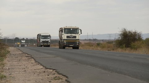 EMALI, KENYA, July 1st 2016: Trucks, lorries, cars and other vehicles driving to and from Nairobi and Mombasa on a stretch of the Mombasa road.