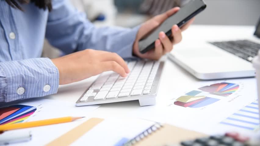 Businessman working with laptop in open space office. Meeting report in progress. | Shutterstock HD Video #33542506