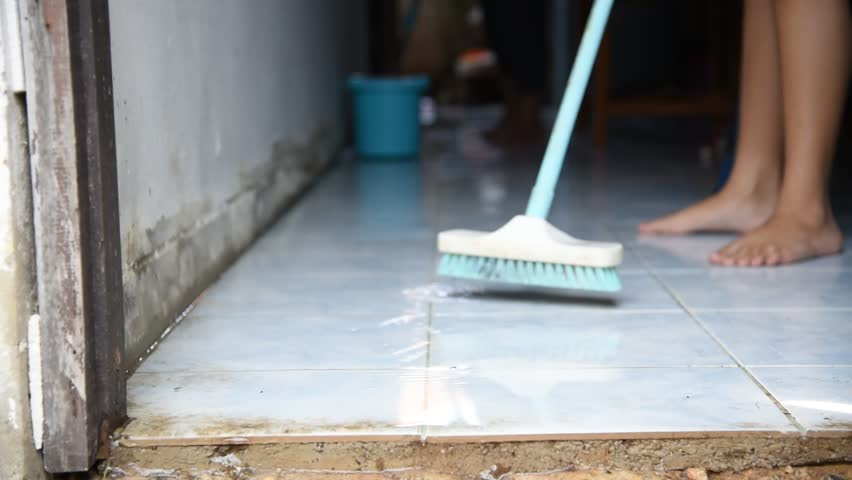 People are cleaning the floor. | Shutterstock HD Video #33544096