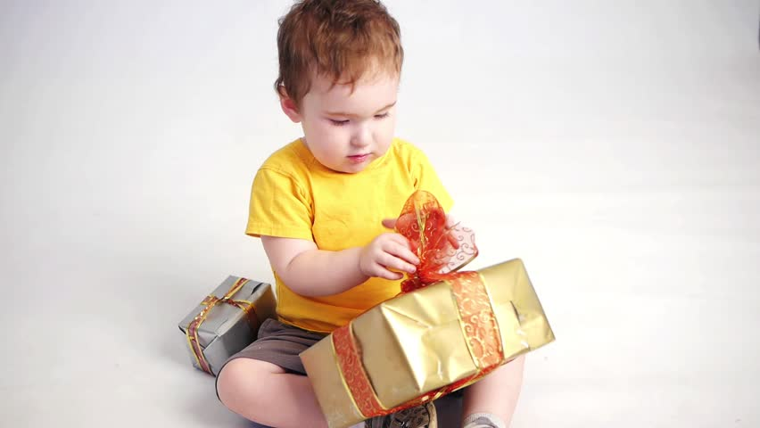boy playng with gift boxes