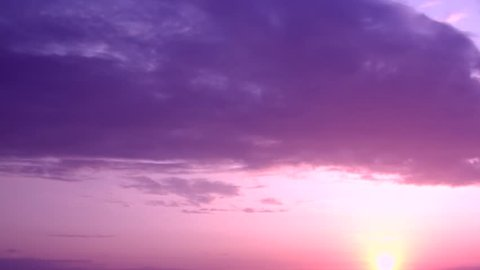 Sunrise time lapse. Aerial pan shot over clouds during beautiful sunrise. Red sun disk time lapse dawn with flowing cloud waves HDR, Beautiful orange sunset, time lapse. Full HD sunrise weather.