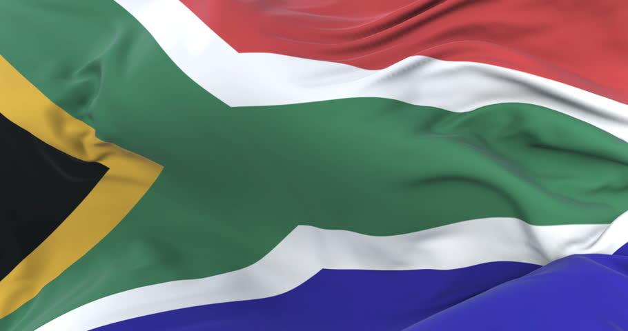 Flag of South Africa waving at wind in slow in blue sky, loop