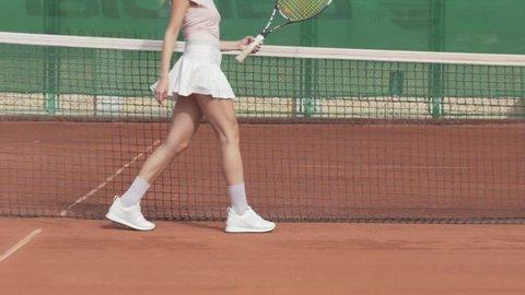 Sexy tennis woman posing at the camera
