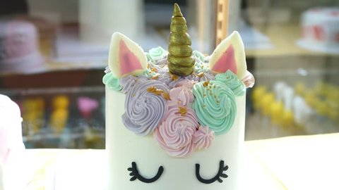 Unicorn Cake In Bakery. Closeup. 4K.