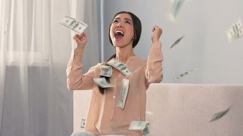 Girl sincerely rejoicing money falling from sky, winning lottery, slow motion