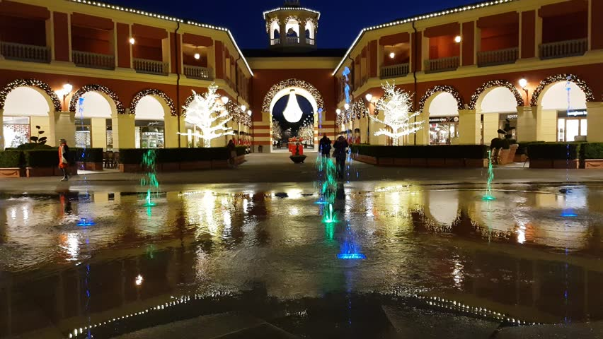 d4f14f7e30a7 SERRAVALLE SCRIVIA, ITALY December 5 2017, The colorful water fountain show  in the night in one of the famous shopping outlet in italy with christmas  tree ...