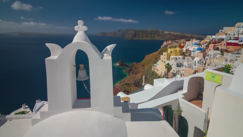 Sunny day santorini island oia town bell coastline panorama 4k timelapse greece | Shutterstock HD Video #33707656