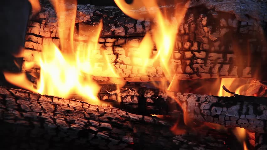 Seamless loop features burning logs in a campfire with dancing flames and glowing embers. Filmed at 1920x1080p HD widescreen.