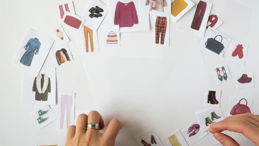 The stylist selects a wardrobe using the example of paper decorations