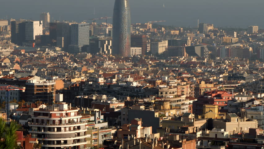 Barcelona cityscape, tilt from houses to Torre Agbar and ocean.