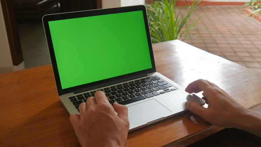 Man use laptop at home with Green Screen. Freelancer works at home. | Shutterstock HD Video #33780346